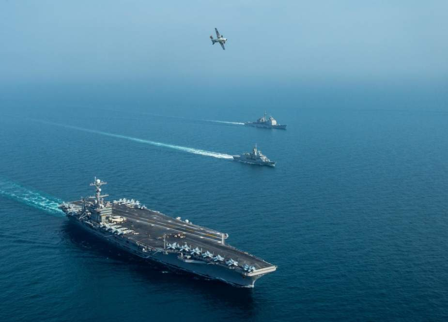 This US Navy photo obtained January 21, 2019 shows the aircraft carrier USS John C. Stennis (CVN 74)(L) the Royal Australian Navy frigate HMAS Ballarat (FFH 155), and the guided-missile cruiser USS Mobile Bay (CG 53(R), sailing in formation as a C-2A Greyhound, assigned to Fleet Logistics Combat Support Squadron (VRC) 30, detachment 4, conducts a flyover in the Persian Gulf, January 16, 2019, during exercise Intrepid Sentinel.