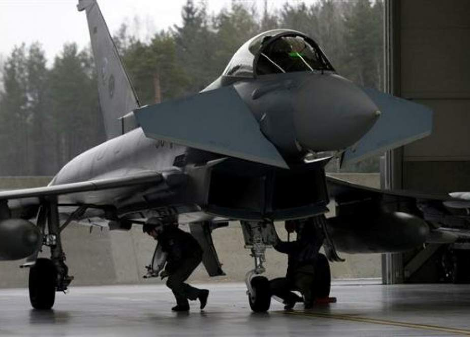 German Air Force technicians inspect Eurofighter Typhoon during an air policing scramble in Amari air base, Estonia, on March 2, 2017. (File photo by Reuters)