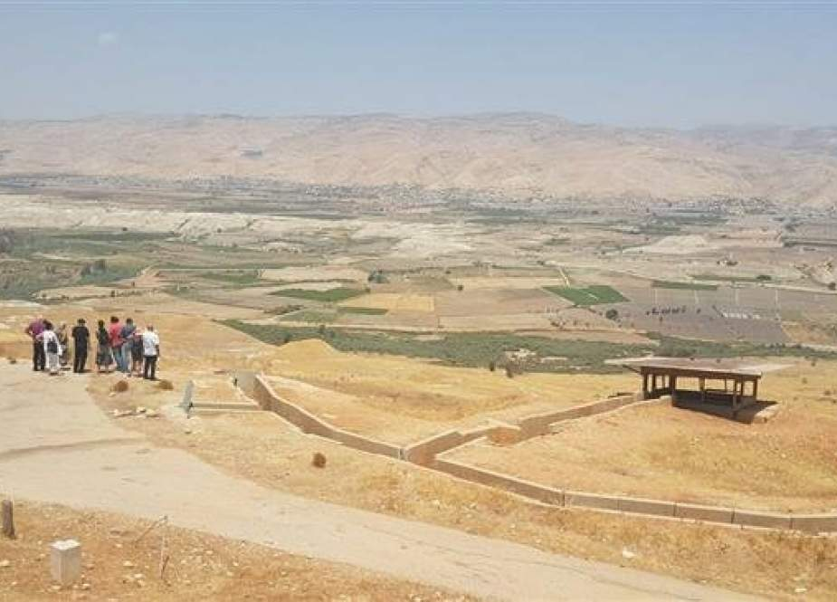 Israeli settlers get a tour of the site of a Jordan Valley outpost.jpg