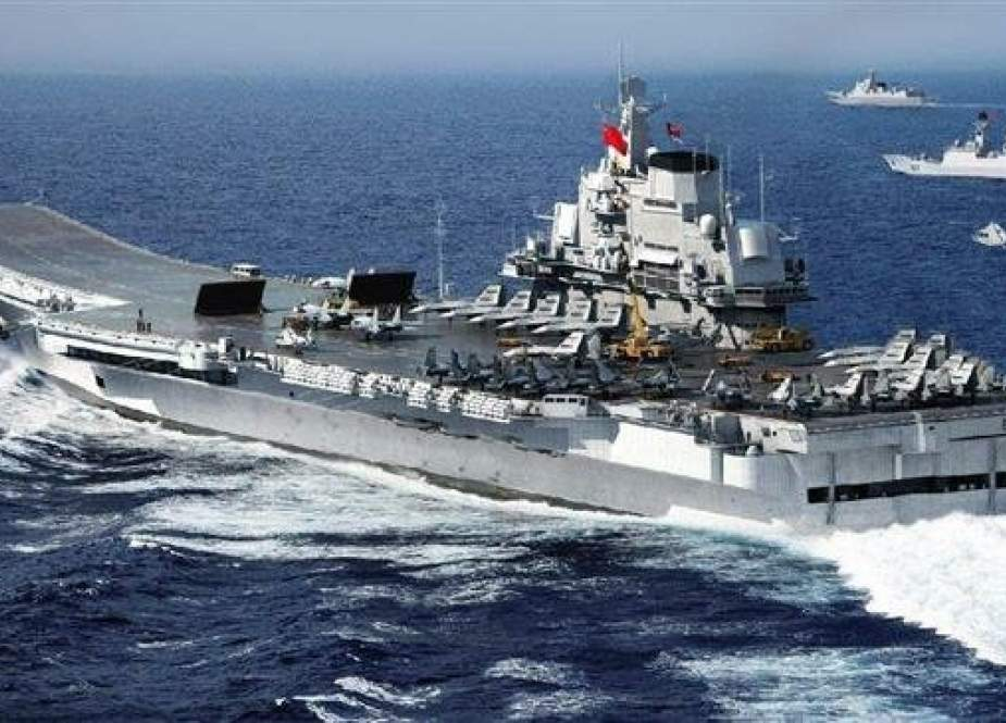 "China says it will ""reveal"" new nuclear submarines, destroyers, and fighter aircraft at a naval parade."