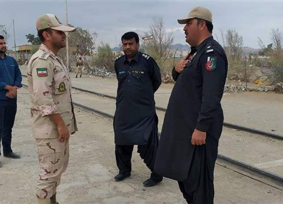 Iranian border official meeting with a Pakistani border security official at Zero Point in an Iran-Pakistan border.jpg