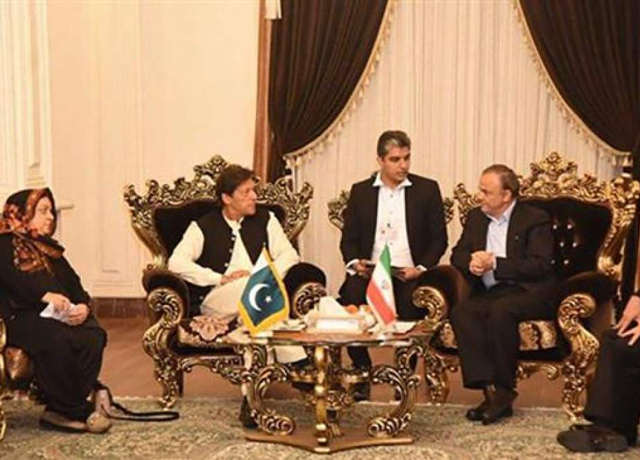Pakistani Prime Minister Imran Khan (2nd L) talks to Governor of Razavi Khorasan Province Alireza Razm Hosseini in the Iranian city of Mashhad.jpg