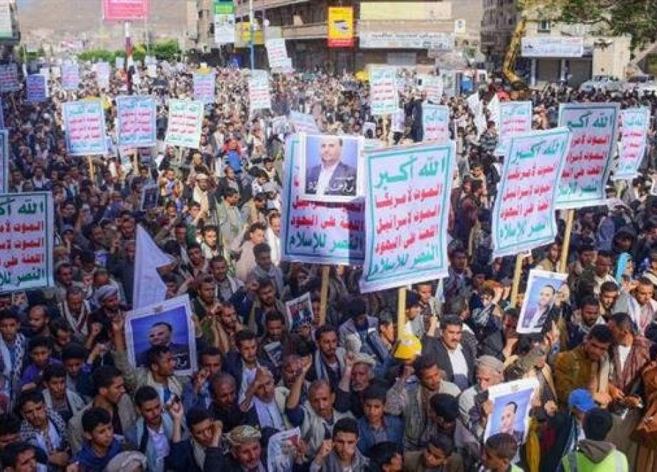 Yemeni protesters rally to mark the first anniversary of the assassination of Saleh al-Samad, a senior official from the Houthi Ansarullah movement, in the capital, Sana'a, on April 19, 2019.