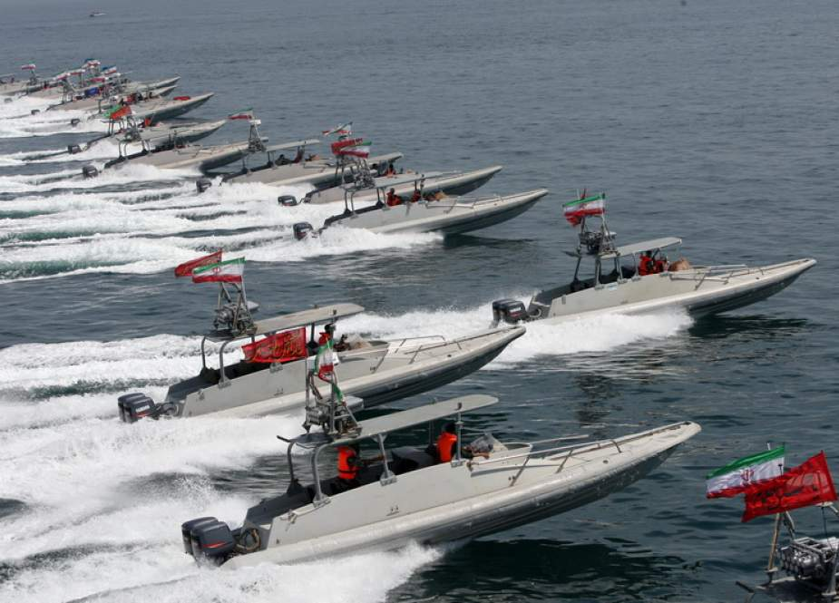 The file photo shows IRGC speedboats in the Persian Gulf