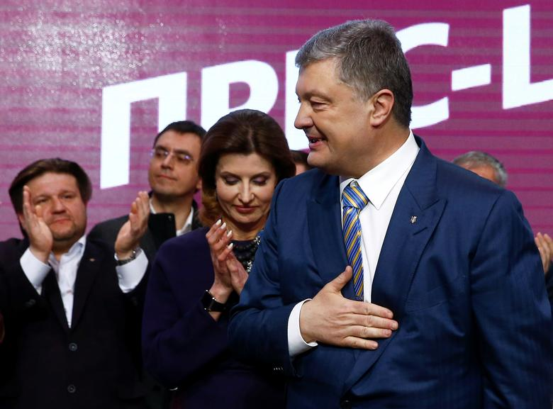 Ukraine's President and presidential candidate Petro Poroshenko reacts following the announcement of the first exit poll at his campaign headquarters in Kiev