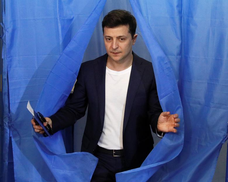 Ukrainian presidential candidate Volodymyr Zelenskiy walks out of a voting booth during the second round of the presidential election in Kiev
