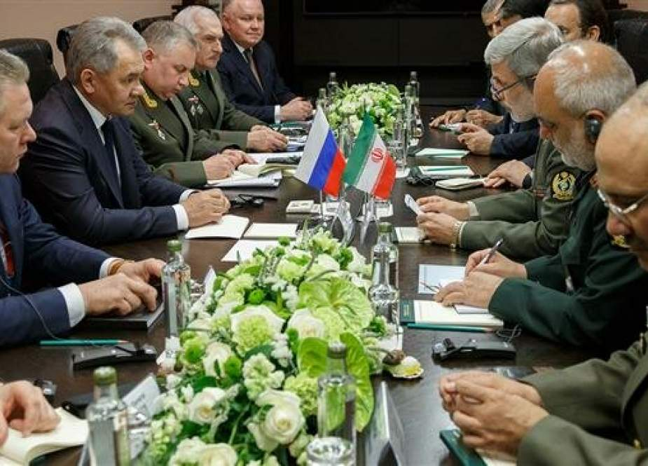 Iranian Defense Minister Brigadier General Amir Hatami and his Russian counterpart Sergei Shoigu meet on April 26, 2019, in Moscow on the sidelines of the Moscow Conference of International Security (MCIS). (Photo by the Russian defense ministry
