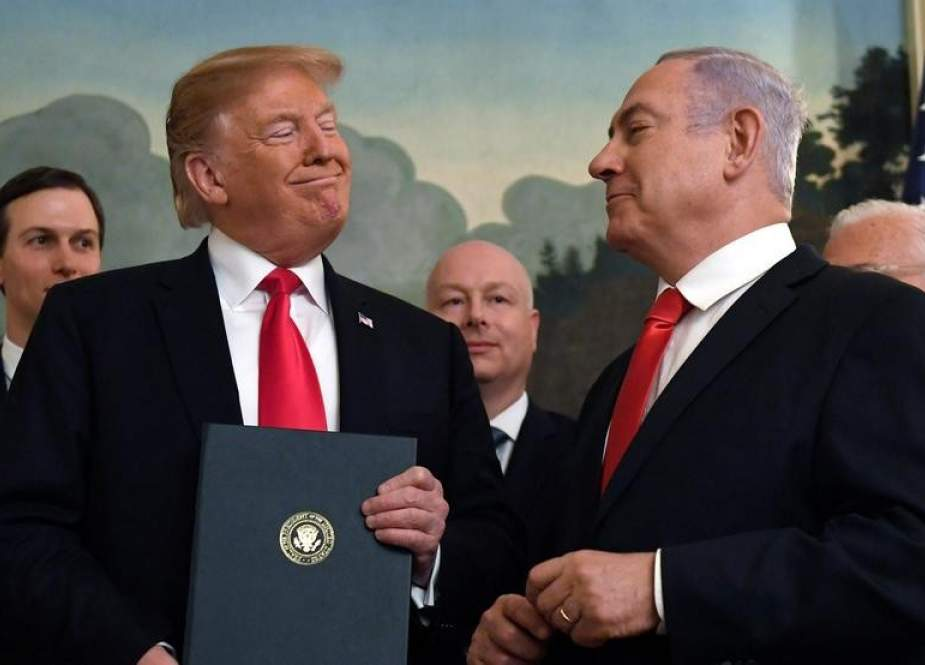 US President Donald Trump (left) listens as Israeli Prime Minister Benjamin Netanyahu speaks in the Diplomatic Reception Room at the White House in Washington, Monday, March 25, 2019.