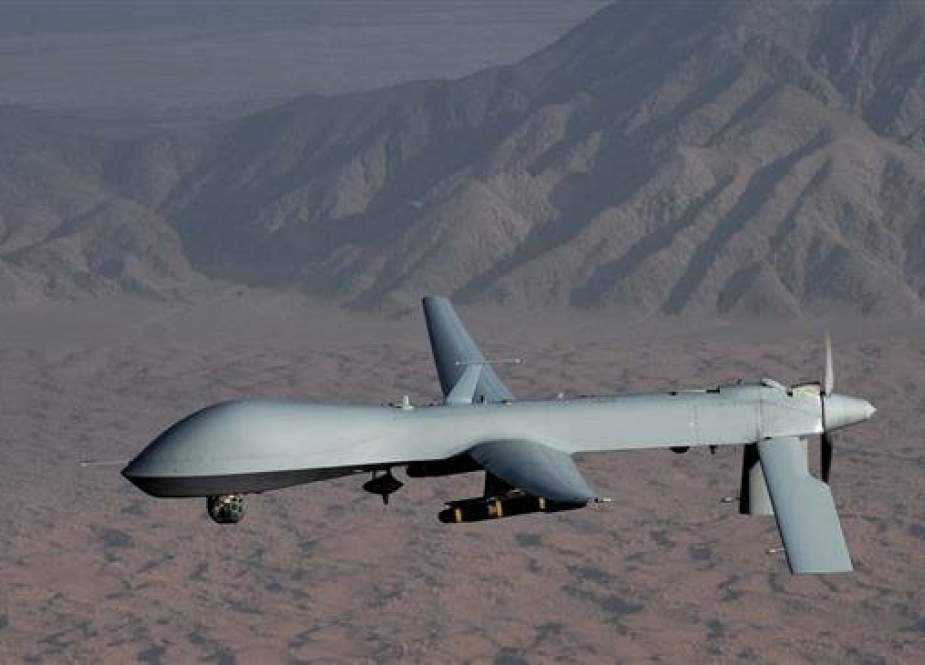 This file picture shows a US-built MQ-1 Predator drone equipped with Hellfire air-to-surface missiles under its wings.