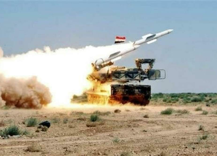 The file photo shows a Syrian air defense battery in action.
