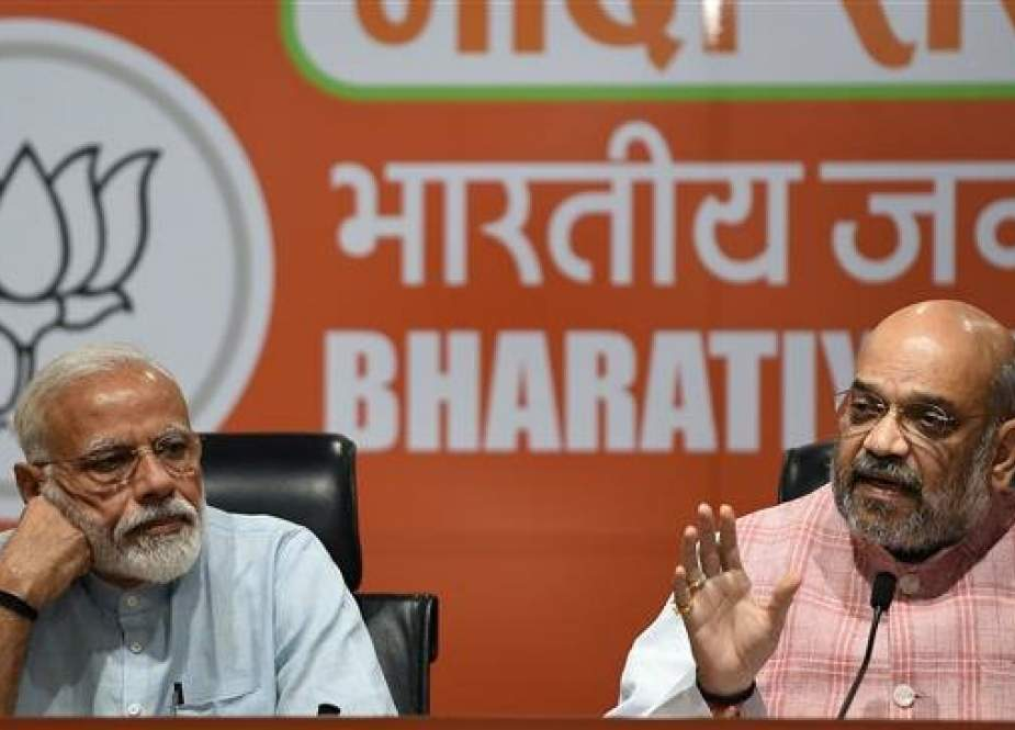 Indian Prime Minister Narendra Modi (L) and Bharatiya Janata Party president Amit Shah take part in a press conference in New Delhi, India, on May 17, 2019. (Photo by AFP)