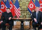 North Korean leader Kim Jong-un sitting with US President Donald Trump.jpg