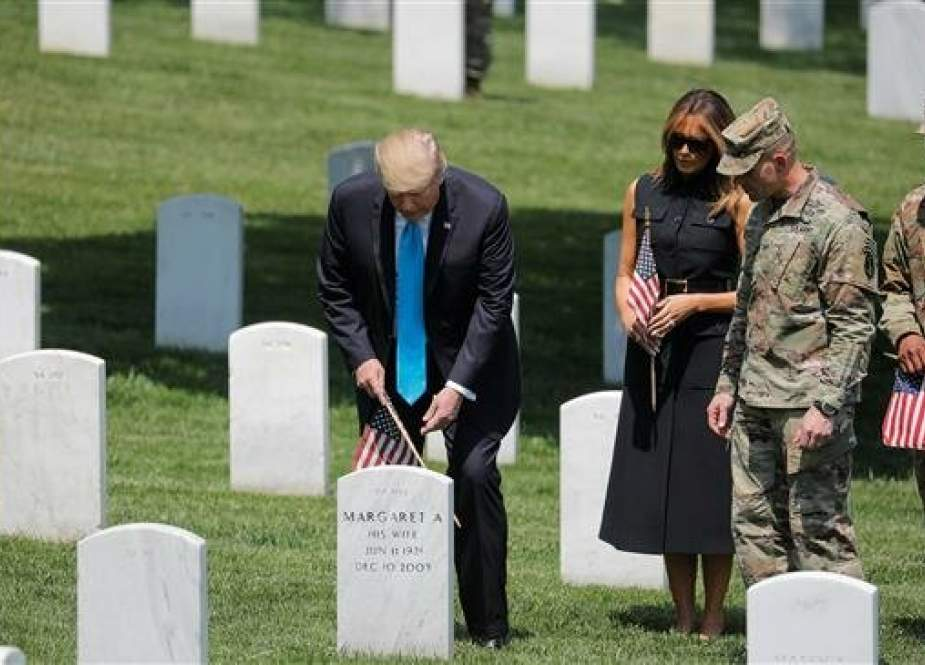 US President Donald Trump visits Arlington National Cemetery outside Washington in Arlington, Virginia on May 23, 2019. (Photo by Reuters)