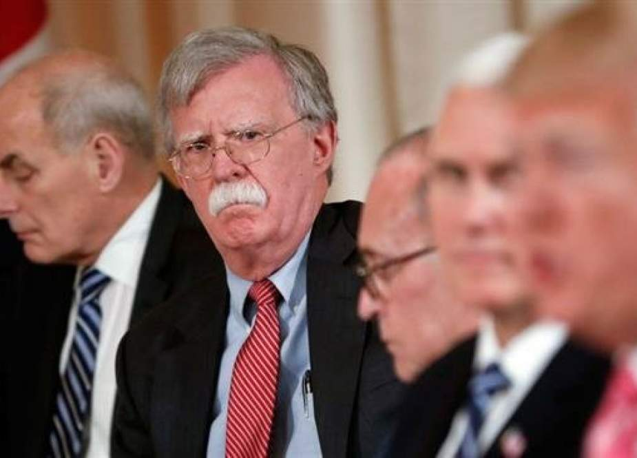 National security adviser John Bolton (2nd-L) listens to President Donald Trump (R) speak (Photo by AP)