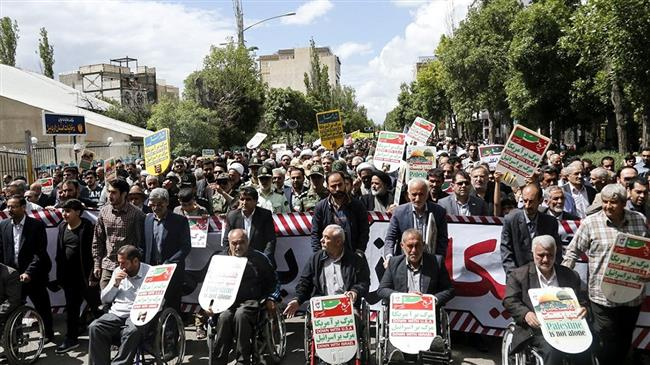 Iranians mark the International Quds Day in Ardabil, Ardabil province on May 31, 2019