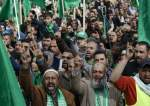 In this file picture, Hamas supporters attend a rally marking the 30th anniversary of the Palestinian resistance movement in Shechem, the occupied West Bank. (By the Associated Press)
