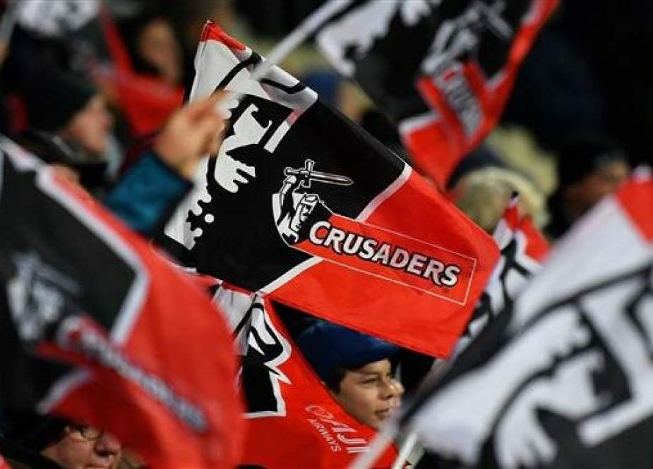 Canterbury Crusaders fans celebrate during a Super Rugby match at their home stadium in Christchurch. (Photo by AFP)
