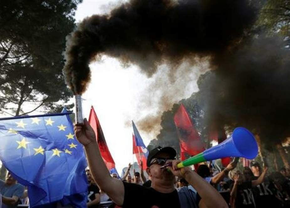 An opposition supporter carrying a smoke can attends an anti-government protest, calling on Prime Minister Edi Rama to step down, in Tirana, Albania, June 8, 2019. (Photo by Reuters)