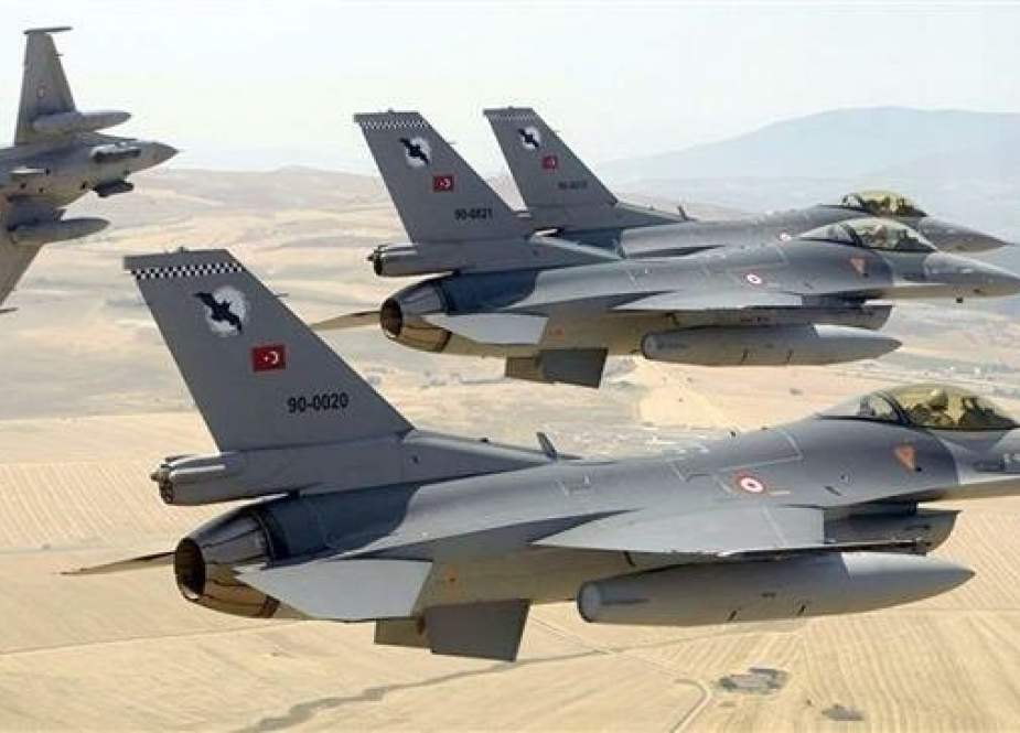 This file picture shows Turkish F-16 fighter jets flying in formation.