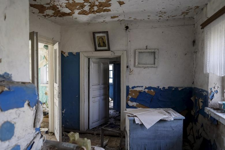 A portrait in a house in the abandoned village of Zalesye