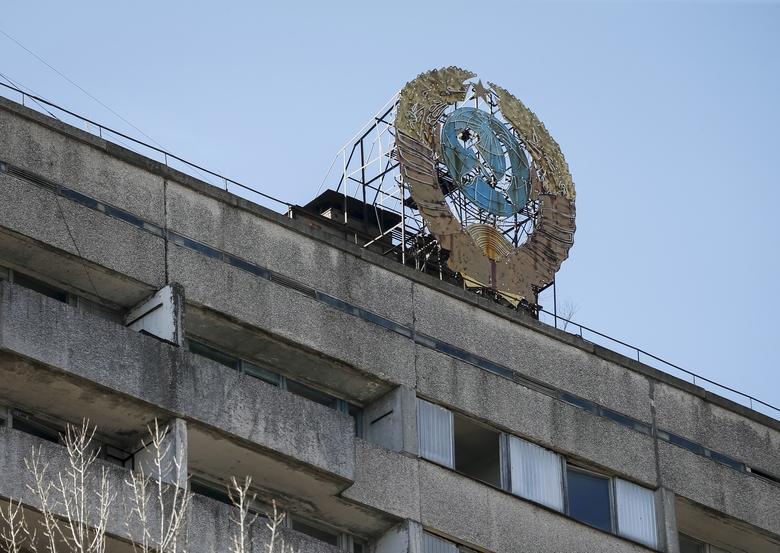 The coat of arms of the former Soviet Union on the roof of a building in the abandoned city of Pripyat