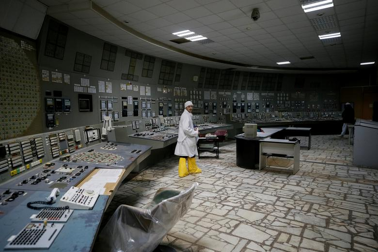 An employee in the control center of the stopped third reactor at the Chernobyl nuclear power plant