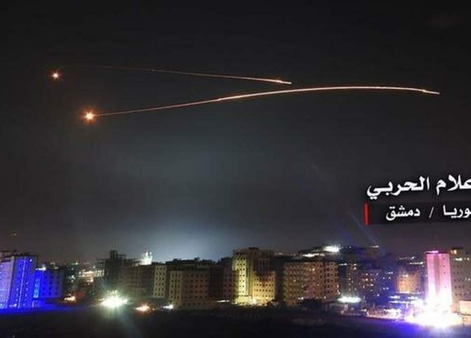 This file picture by the media bureau of the Syrian Joint Operations Command purportedly shows Syrian air defense systems intercepting Israeli missiles over Damascus