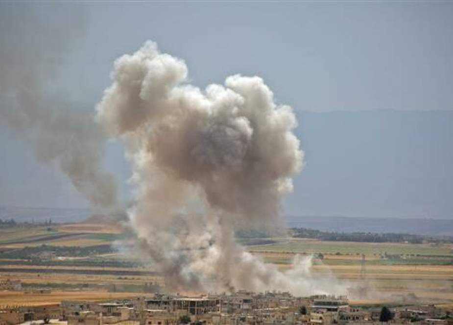 Smoke billows during shelling by Syrian forces in Idlib. (Photo by AFP)