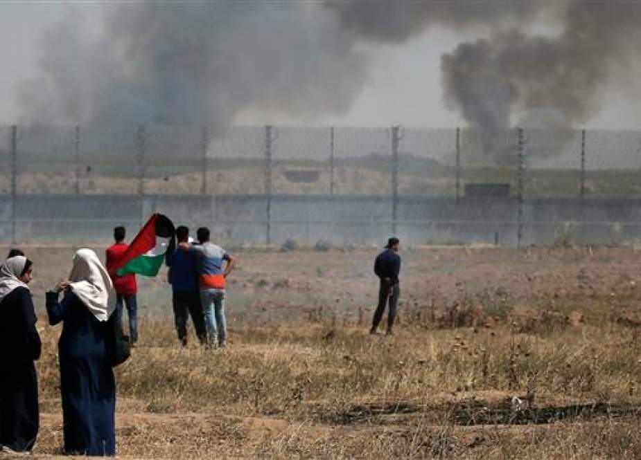Palestinians protest by the fence separating Gaza from Israeli-occupied territories, east of Gaza City, the Gaza Strip, on May 15, 2019. (Photo by AFP)