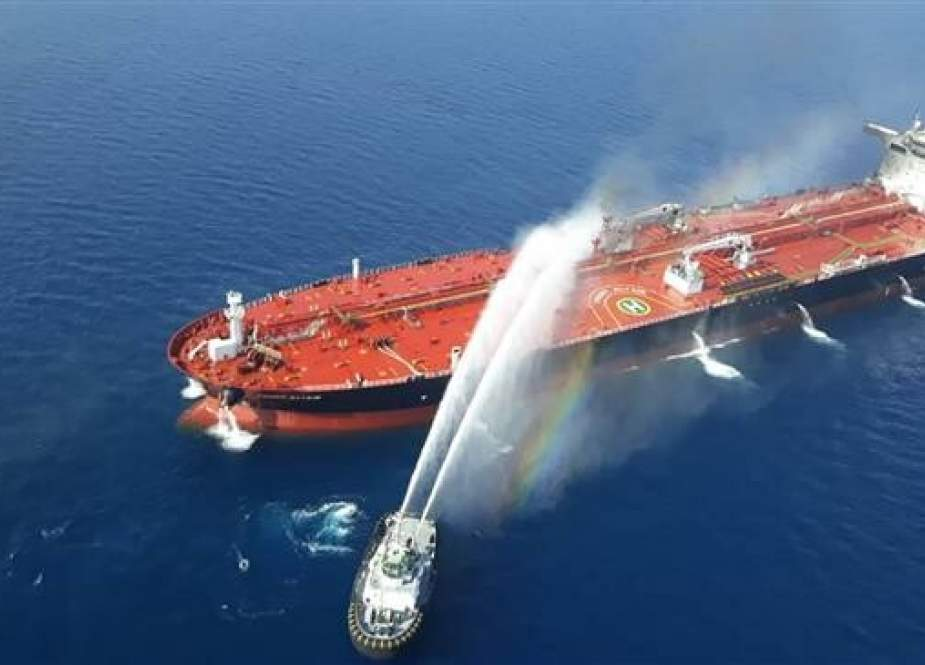 Iranian Navy boat trying to control fire from Norwegian-owned Front Altair tanker.jpg