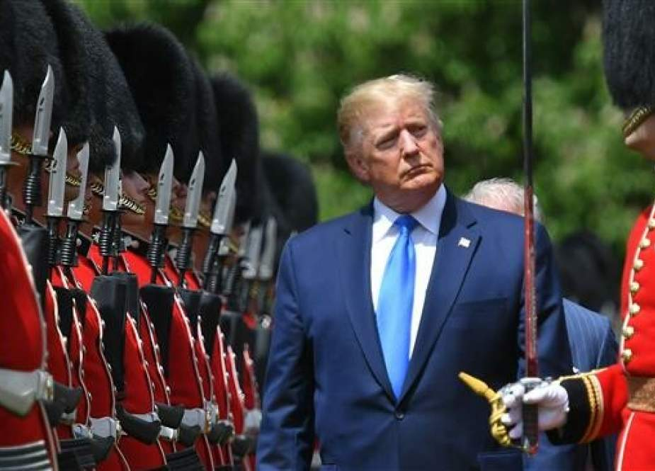 In this file photo taken on June 3, 2019, US President Donald Trump inspects an honor guard during a welcome ceremony at Buckingham Palace in central London. (Photo by AFP)