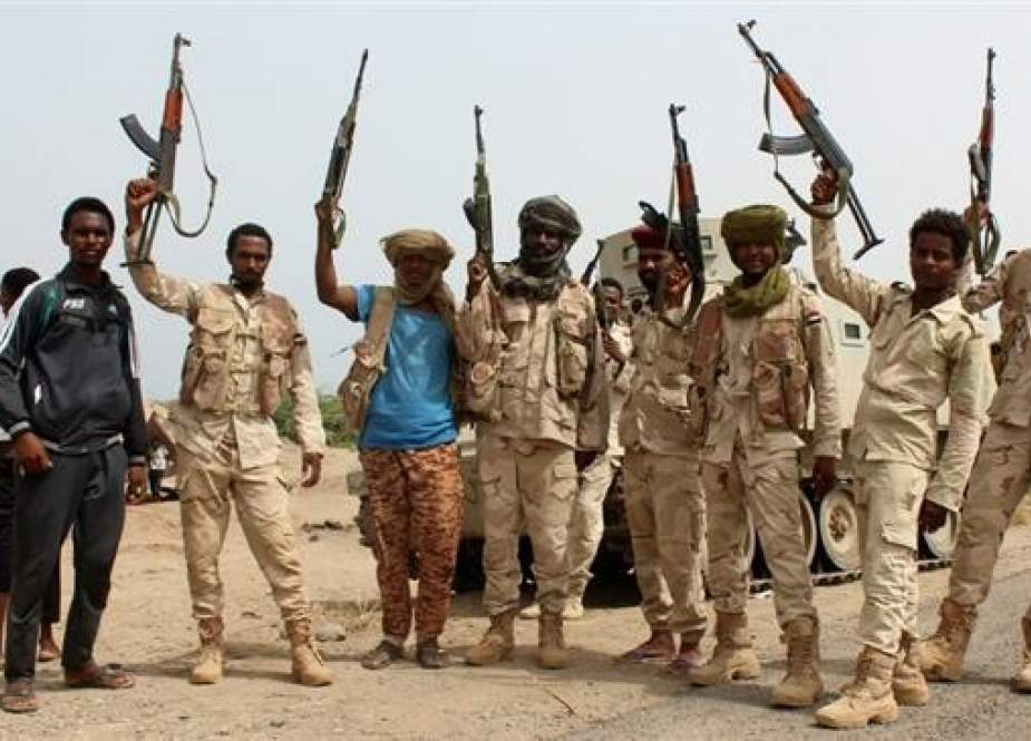 This file picture shows Sudanese fighters battling alongside Saudi-backed militiamen against Houthi Ansarullah fighters in Yemen. (Photo by AFP)