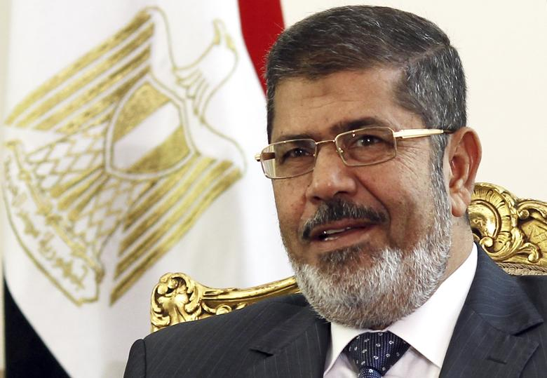 Egypt's President Mohamed Mursi attends a meeting with Palestinian President Mahmoud Abbas at El-Thadiya presidential palace in Cairo May 16, 2013