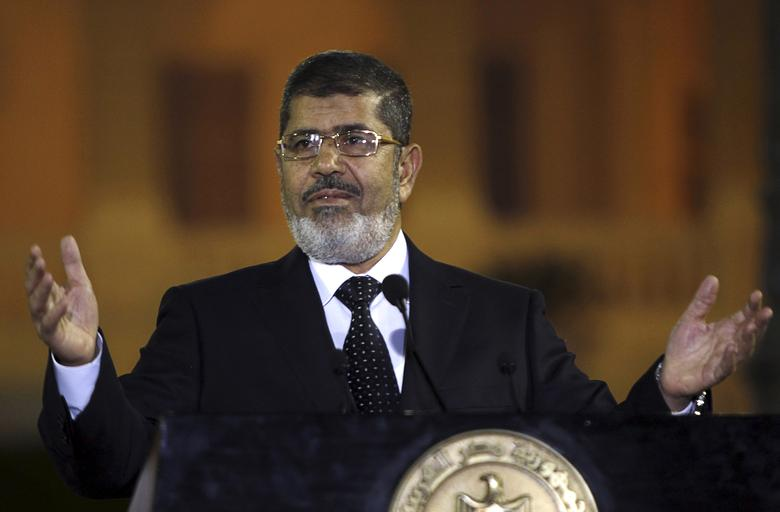 Egyptian President Mohamed Mursi speaks during a news conference with Turkish President Abdullah Gul (not pictured) after their meeting at Presidential Palace