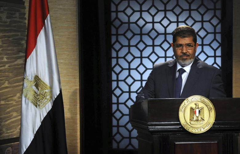 Muslim Brotherhood's president-elect Mohamed Mursi speaks during his first televised address to the nation at the Egyptian Television headquarters in Cairo June 24, 2012