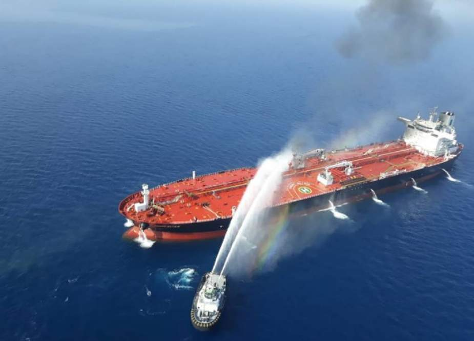 A picture provided by Iranian news agency Tasnim on June 13, 2019 reportedly shows an Iranian navy boat trying to control fire from Norwegian owned Front Altair tanker reportedly attacked in the waters of the Gulf of Oman. (Photo via AFP)