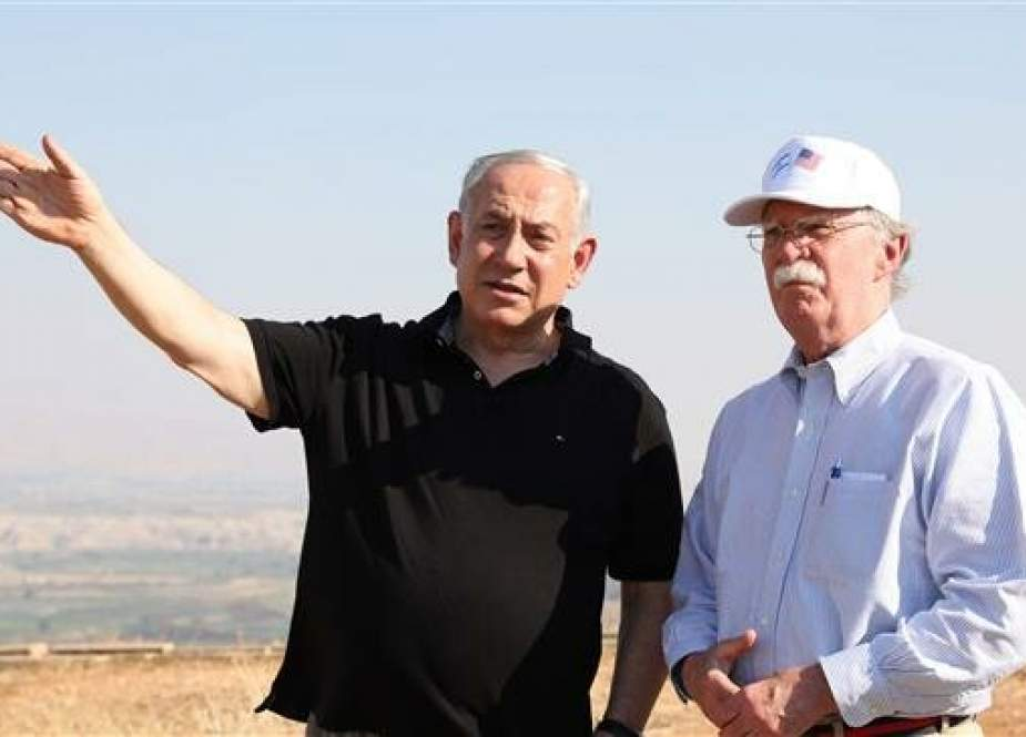 Israeli Prime Minister Benjamin Netanyahu (left) and US National Security Advisor John Bolton visit an old army outpost in Israel on June 23, 2019. (AFP photo)