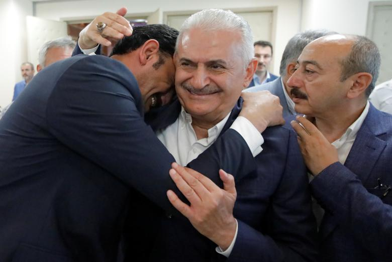 Binali Yildirim, mayoral candidate of the ruling AK Party, is greeted by a supporter at his party's Istanbul headquarters in Istanbul, June 23