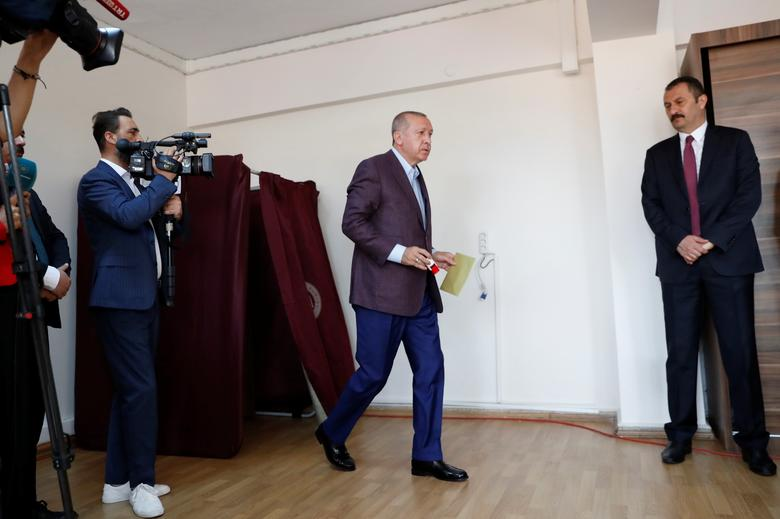 Turkish President Tayyip Erdogan leaves a voting booth before casting his ballot, at a polling station in Istanbul, June 23