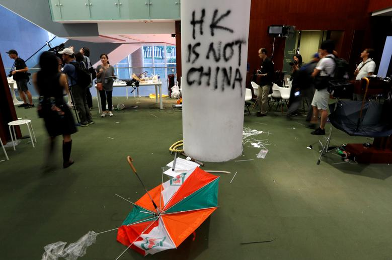 A view shows damages inside the Legislative Council building. Debris including umbrellas, hard hats and water bottles were the few signs left of the mayhem that had engulfed parts of the Chinese-ruled city overnight after protesters stormed and ransacked
