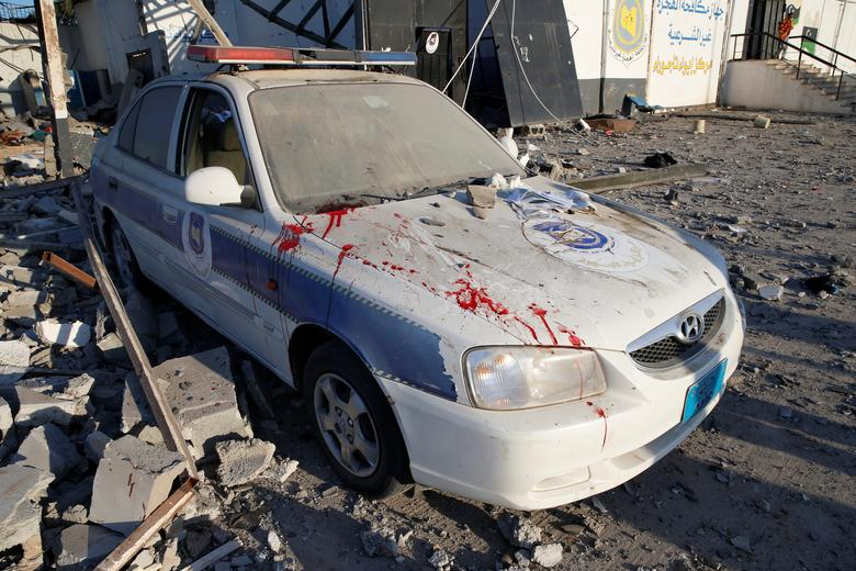 Blood stains are seen on a police car at a detention centre for mainly African migrants, hit by an airstrike in the Tajoura suburb of Tripoli, July 3. It was the highest publicly reported toll from an air strike or shelling since eastern forces under Kha
