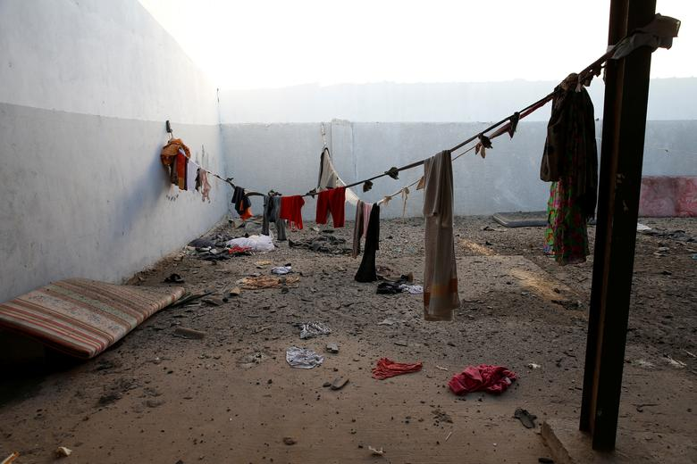 Migrants' clothes are seen at a detention centre for mainly African migrants, hit by an airstrike in the Tajoura suburb of Tripoli, July 3
