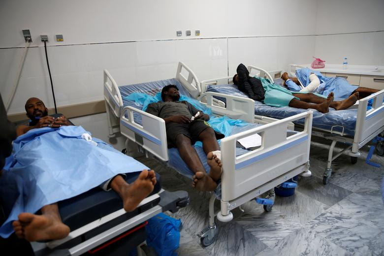 Wounded migrants lie on hospital beds after an air strike hit a detention center for mainly African migrants in Tajoura, in Tripoli Central Hospital, July 3