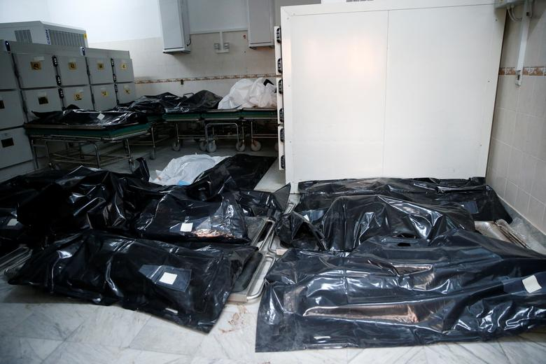 Bags with bodies of migrants who died after an air strike hit a detention center for mainly African migrants in Tajoura are seen in Tripoli Central Hospital, July 3