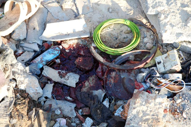 Blood stains are seen amidst debris at a detention centre for mainly African migrants, that was hit by an airstrike, in the Tajoura suburb of Tripoli, July 3