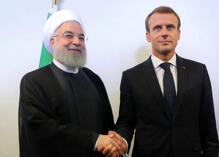 In this file photo taken on September 25, 2018 Iranian President Hassan Rouhani (L) meets with French President Emmanuel Macron on the sidelines of the UN General Assembly at the UN headquarters in New York. (AFP photo)