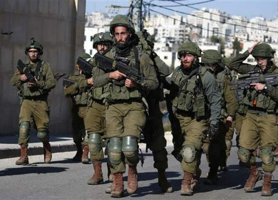 Israeli troops withdraw from Ramallah in the occupied West Bank on December 15, 2018 after blowing up a house belonging to a Palestinian accused of killing an Israeli soldier. (Photo by AFP)
