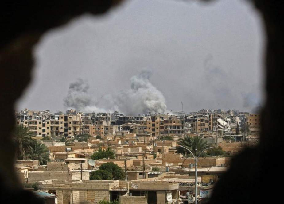 This file picture shows smoke billowing out following a US-led coalition airstrike in the western al-Daraiya neighborhood of the embattled northern Syrian city of Raqqah. (Photo by AFP)