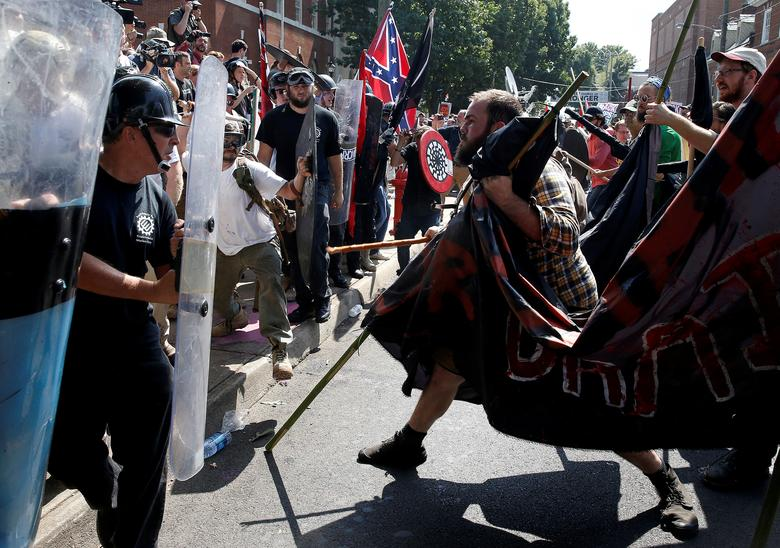 August 2017 - After a rally by white supremacists in Charlottesville, Virginia in which a neo-Nazi drove a car into a crowd, killing a woman, May rebukes Trump for saying counter-protesters were also to blame for the violence. Pictured: White supremacist