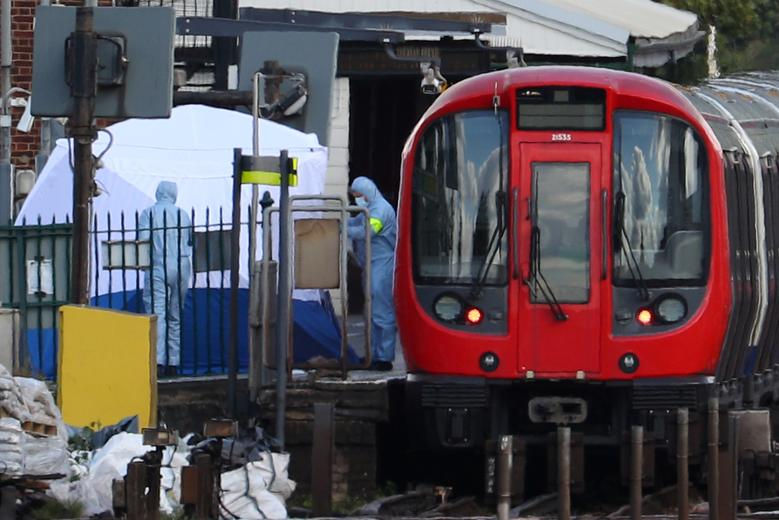 September 2017 - Following the attempted bombing of a train in London, May says it is unhelpful for anyone to speculate about the attack after Trump tweets that London police had the suspects in their sights. Pictured: Forensic investigators search on th